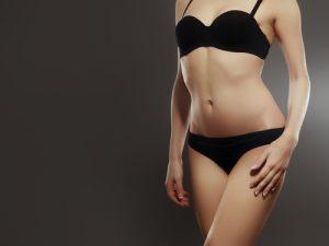 Beautiful sexy female slim tanned body