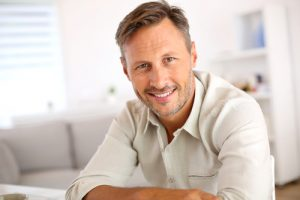 smiling man relaxing at home-img-blog