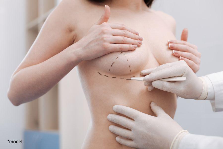 woman preparing for her breast augmenation