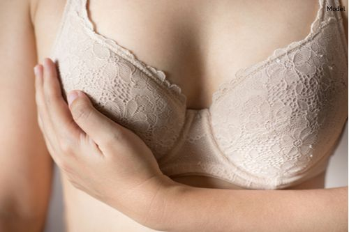 woman-touching-breast-with-beige-bra-img-blog-compressor
